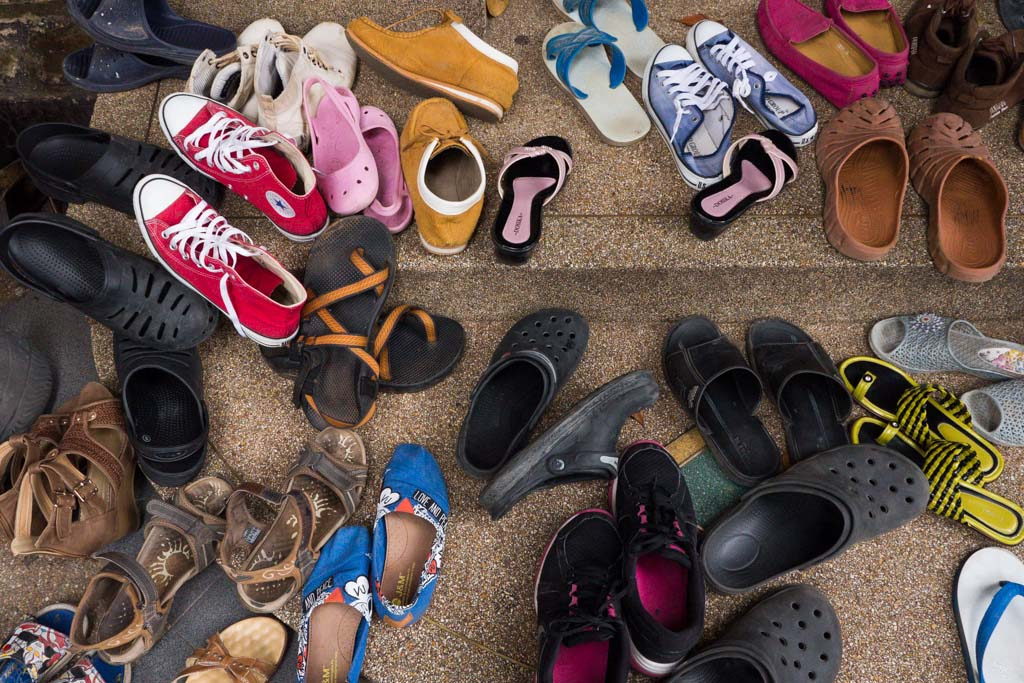 Shoes outside of a temple Thailand